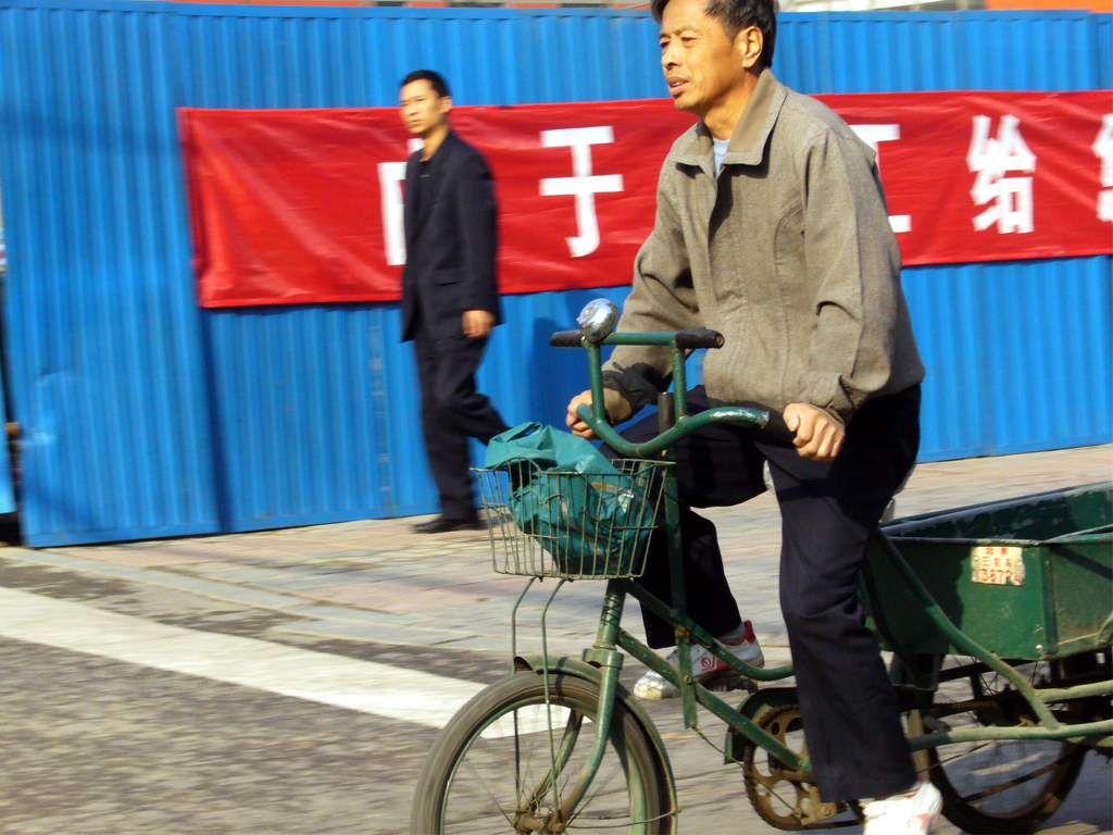Chinese Guy on local bike